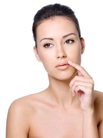 wrinkles: Beautiful calm young woman touching her lips - isolated on white backgrpund Stock Photo