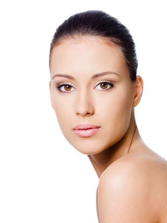 Beautiful young womans face with healthy clean skin photo