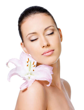 Beautiful portrait of young sensual woman with flower on her shoulder Stock Photo - 8078627