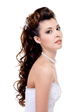 wedding hairstyle: Atractive brunette woman with beauty wedding hairstyle - isolated on white   Stock Photo