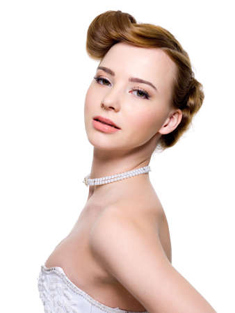 Beautiful bride with fashion wedding hairstyle - isolated on white   photo