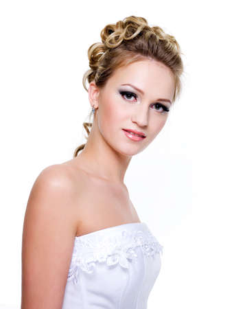 wedding hairstyle: Portrait of a beautiful bride with fashion wedding hairstyle - isolated on white Stock Photo