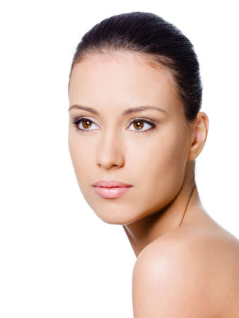 female face closeup: Close-up portrait of beautiful young womans face with healthy clean skin Stock Photo