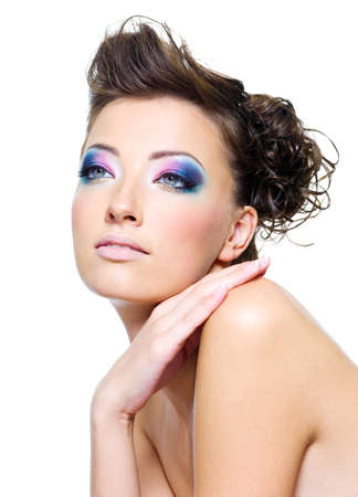 Beautiful woman face with bright make-up and creative hairstyle photo