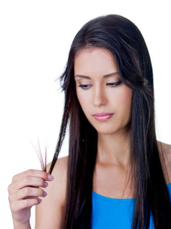 Disappointed young beautiful woman because of tangled long brown hair - isolated Stock Photo - 8197528