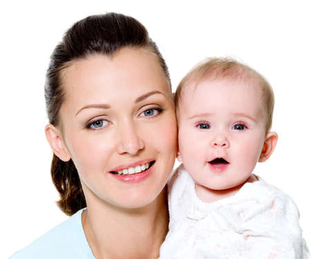 Portrait of a beautiful young mother with sweet newborn child Stock Photo - 8197504