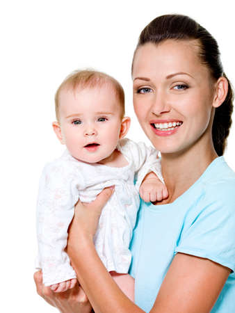Portrait of a beautiful young mother with sweet newborn child photo