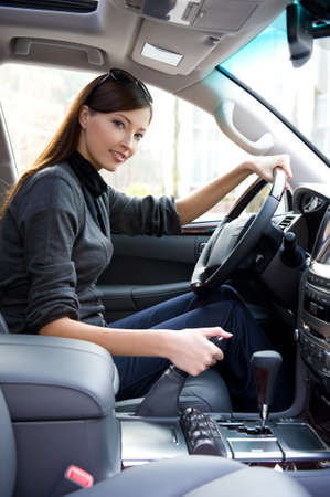beautiful young happy woman posing inside of  the new car Stock Photo - 8211804