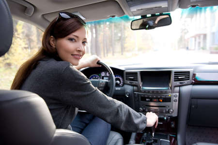 Portrait of beautiful young woman in the new car  - outdoors Stock Photo - 8211823