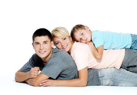 Happy youngl smiling family with little boy  - isolated photo