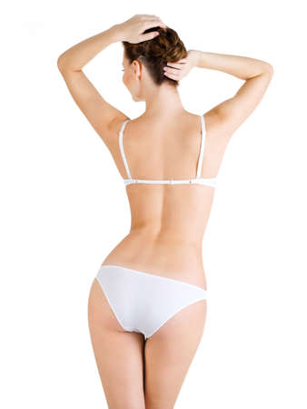 Rear view of  beautiful female body. Isolated on white background. . photo