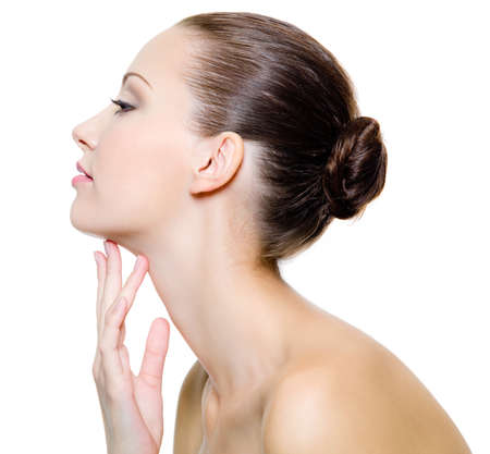 Beautiful woman pampering the neck  - on white background. Profile portrait. Stock Photo - 8354895