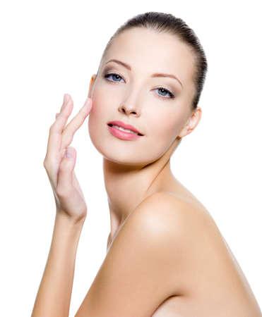 Beautiful woman touching the cheek on face - on white background. Stock Photo - 8354894