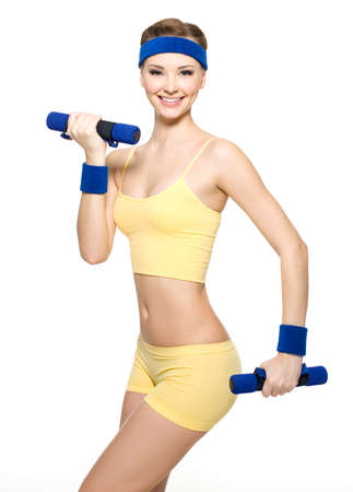 Woman doing fitness exercise with dumbbells isolated on white Stock Photo