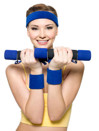 Woman doing fitness exercise with dumbbells isolated on white photo