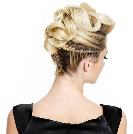 coiffure: Blond female with creative curly  hairstyle, rear view on white background