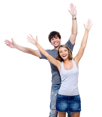 boy standing: Two young happy person with the hands lifted upwards