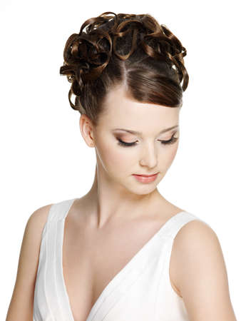 Woman with beautiful hairstyle and brown make-up using long false eyelash, on white background photo