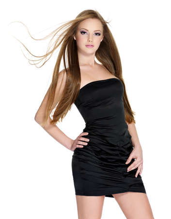 Beautiful sensuality teen girl in black dress with long straight hair isolated on white background Stock Photo - 8559960