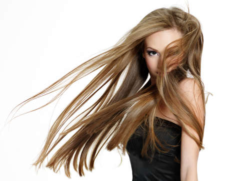 Beautiful teen girl shaking head with long hair on hwite background photo