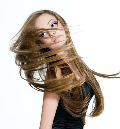 Beautiful teen girl shaking head with long hair on hwite background Stock Photo - 8559955