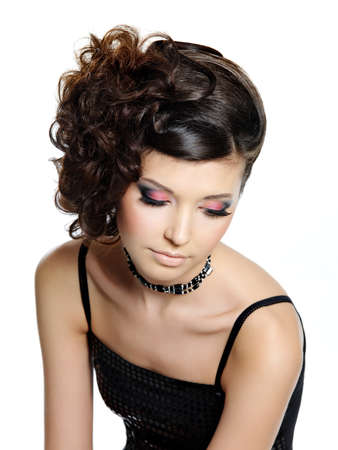 high angle: Beautiful girl with bright glamour eye make-up and modern hairstyle, high angle portrait