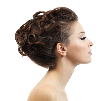 Profile portrait of the beautiful young girl with curly hairstyle -  isolated on white background Stock Photo - 8802709
