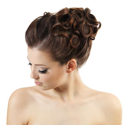 Pretty girl with stylish curly hairstyle. High angle portrait isolated on hwite background photo