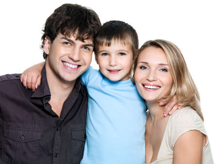 mom and dad: Portrait of happy young family with son - on white background Stock Photo