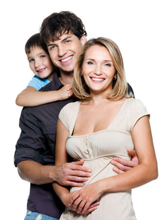 family smiling: Happy young family with pretty child posing on white background