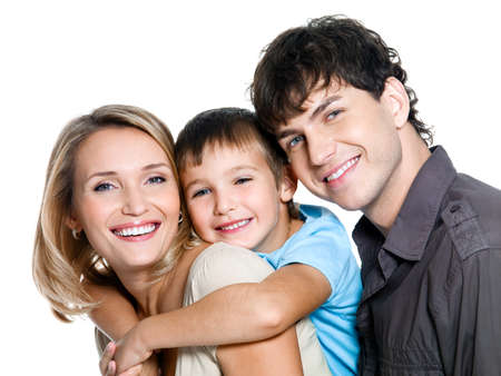 Portrait of happy young family with son - on white background photo