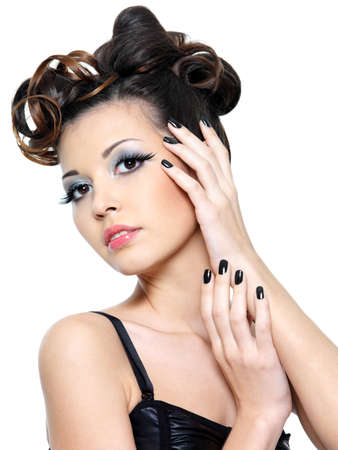 Beautiful sexy woman with creative hairstyle and black nails. Fashion eye make-up Stock Photo - 8928565