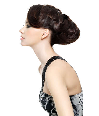 woman profile: Profile of beautiful brunette young woman with fashion hairstyle - isolated