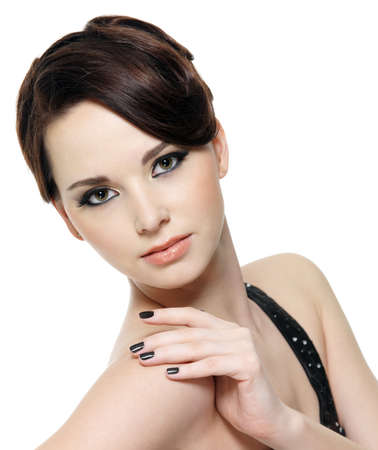brunette: Portrait of beautiful young woman with fashion make-up and manicure - close-up