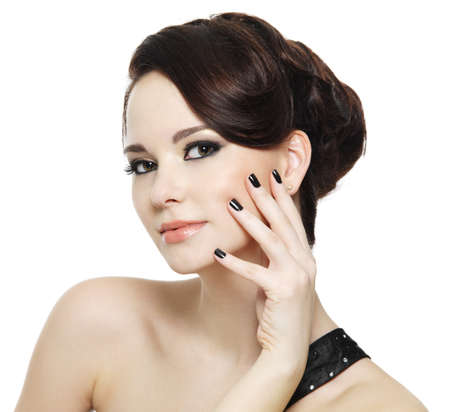 beautiful woman with black nails and bright eye make-up - on white background Stock Photo - 8921857