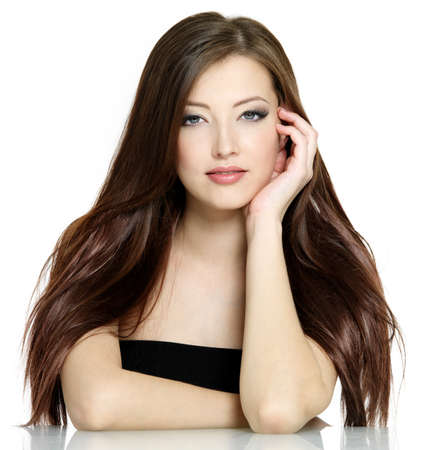 Portrait of young woman with long brown straight hair on white background Stock Photo - 9002509