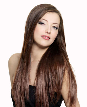 Portrait of young attractive woman with  long gloss hair  photo