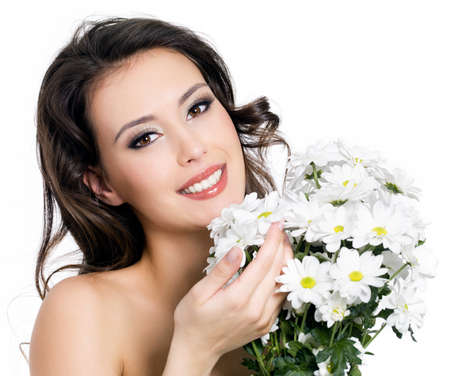 Portrait of happy smiling beautiful young woman with bouquet  flowers - isolated on white Stock Photo - 9002557