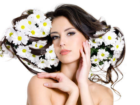 Beautiful sexy woman with  flowers in her long hair - white background Stock Photo - 9002559