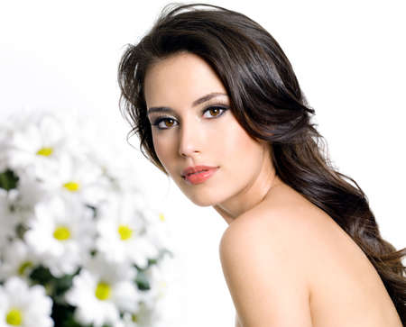 Young attractive woman with clean skin and bouquet of  flowers - isolated on white Stock Photo - 9002553