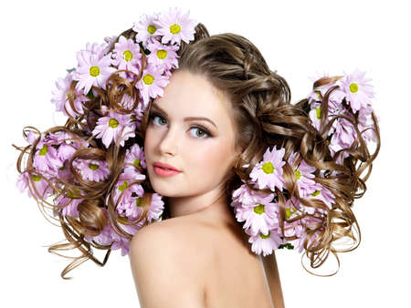 Bouquet of flowers in gorgeous long curly hair of young beautiful sexy woman - white background Stock Photo - 9115424