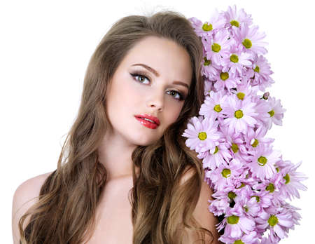 Portrait of beautiful girl with  long hair and spring flowers - white background photo