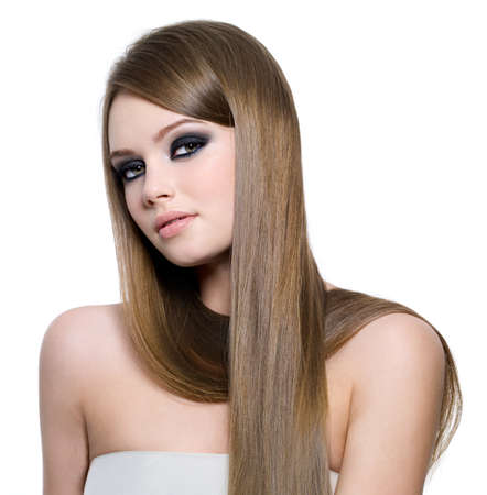 Portrait of beautiful teen girl with long straight hair and black eye make-up - white background photo