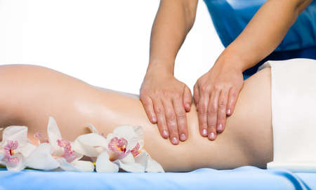 Close-up female back having a resting massage - horizontal Stock Photo - 9115445