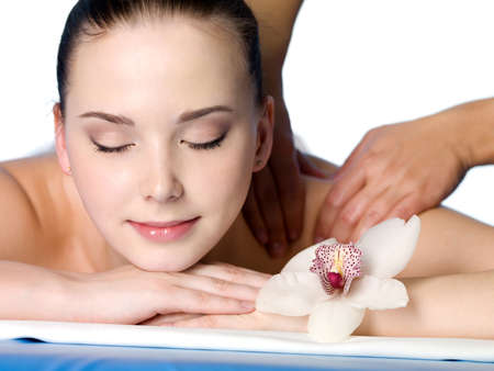 Close-up portrait of young woman having masssage in spa salon - white nackground Stock Photo - 9115436