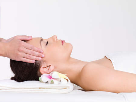 Massage for the face of young beautiful woman - horizontal photo