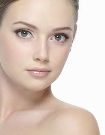 Beautiful clean face of young sexy woman looking at camera -  on  white background Stock Photo - 9244638