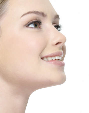 woman profile face: Beautiful smiling face of woman close-up in profile - white background