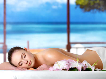 Beautiful young woman relaxing in the spa  salon in a resort - nature background Stock Photo - 9267826