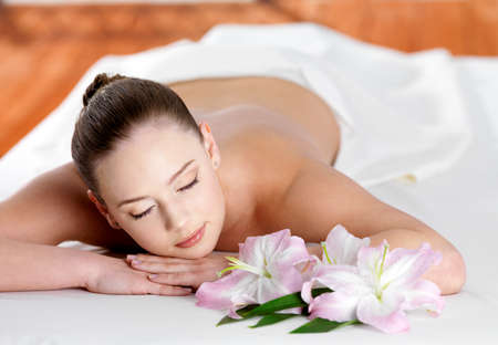 Young beautiful woman joing and relaxing in spa beauty salon - indoors Stock Photo - 9267832